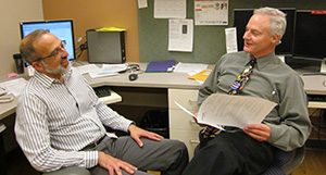 Drs. Greg DeMuri and James Conway comparing notes for a case.