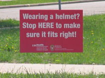 Signs along the route got riders' attention as they approached helmet fit stations.