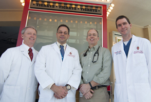 The multidisciplinary pediatric heart program team includes, from left, pediatric intensivist Scott Hagen, MD; pediatric cardiothoracic surgeon Petros Anagnostopoulos, MD; pediatric cardiology chief J. Carter Ralphe, MD, and pediatric interventional cardiologist Luke Lamers, MD.