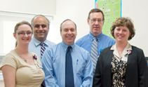 The study team at the bone marrow transplant (BMT) lab, from left: Laboratory Technician Michelle Lindaas, MT (ASCP); BMT Lab Director Peiman Hematti, MD; Kenneth DeSantes, MD; Laboratory Technician Ron Oilschlager, MT (ASCP) SBB; and Clinical Research Associate Jenny Kimball.